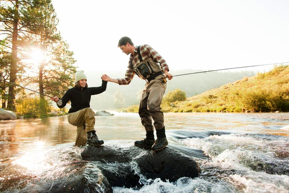 Couple fishing in river